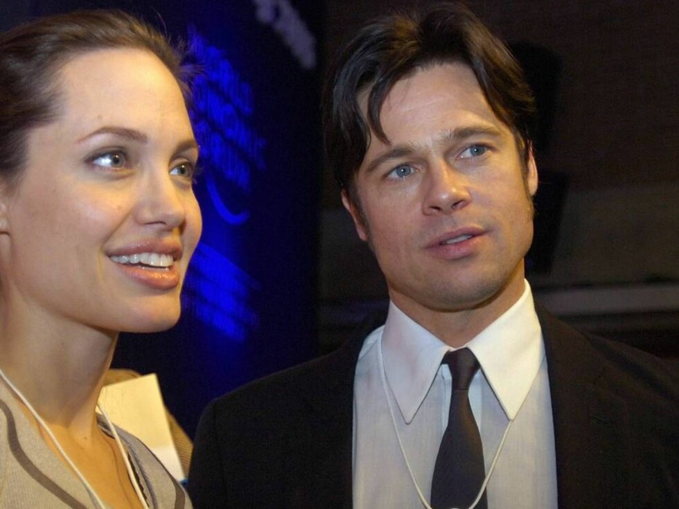 ** FILE ** Angelina Jolie, left, and Brad Pitt attend the World Economic Forum in Davos, Switzerland, in this Thursday, Jan. 26, 2006 file photo.  Brad Pitt's publicist announced Saturday, May 27, 2006 that Angelina Jolie has given birth to the couple's c Foto: AP/SCANPIX
