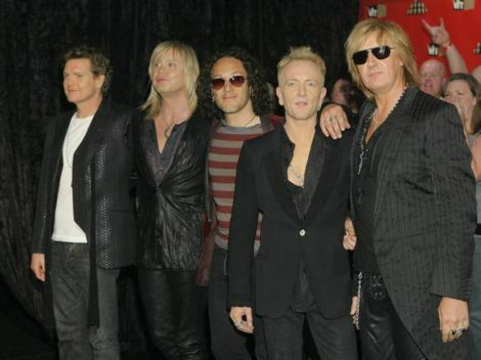 Members of rock group Def Leppard pose for photographers as they arrive for VH1 Rock Honors concert in Las Vegas on Thursday, May 25, 2006.  (AP Photo/Jae C. Hong) Foto: Scanpix, AP