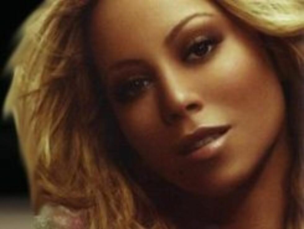 SEXY BEIN: Mariah har fosikret sine undersåtter. Foto: Topp.no