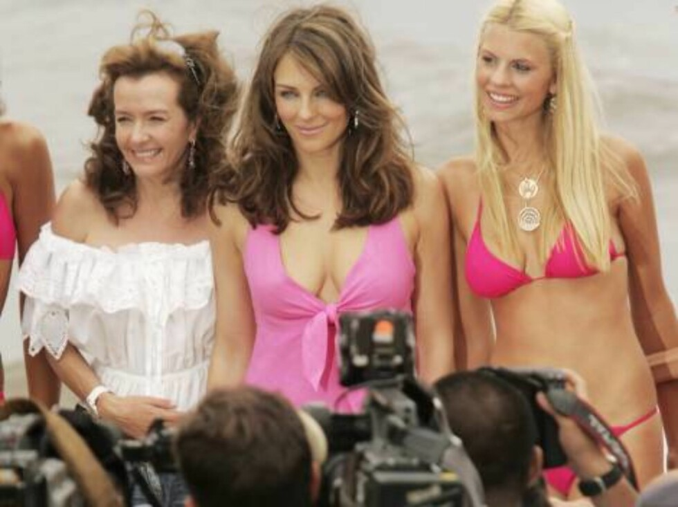 CANNES, FRANCE - MAY 23:  Co-President of Chopard Caroline Gruosi-Scheufele (L) and British model Elizabeth Hurley (C) pose for a picture at Nikki Beach during the 59th International Cannes Film Festival on May 23, 2006 in Cannes, France.  (Photo by Peter Foto: All Over Press