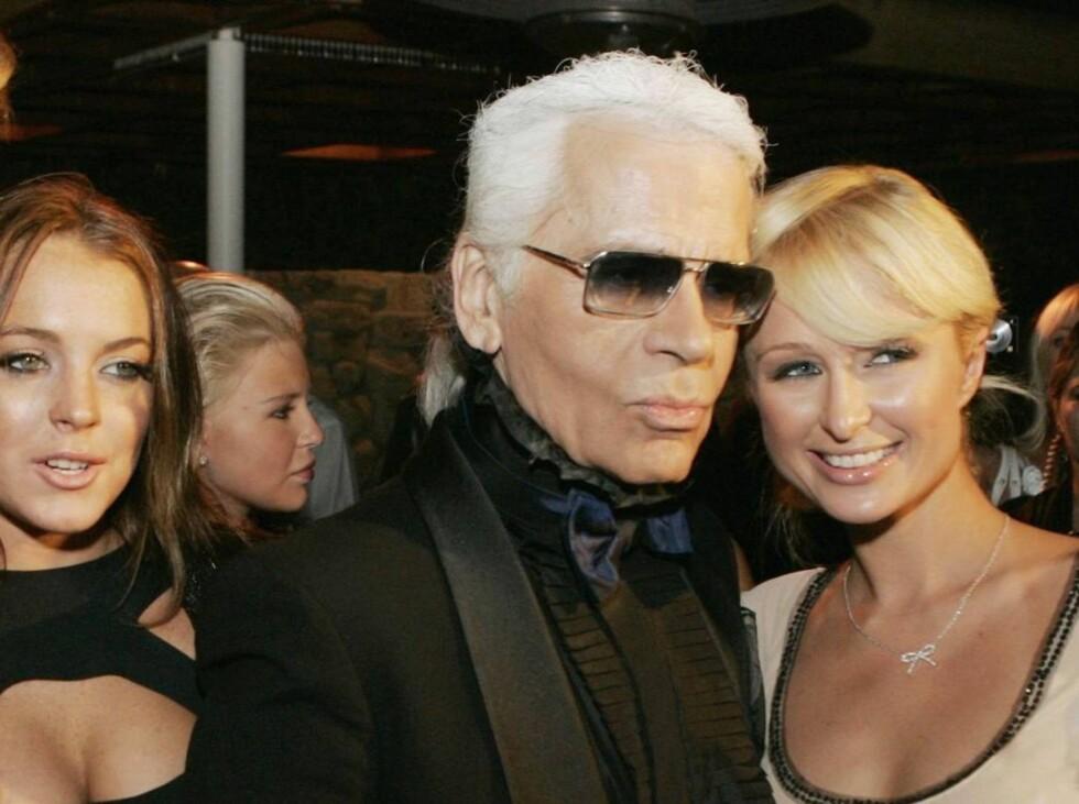MEG FØRST: Paris Hilton og Lindsay Lohan kappes om å sole seg i glansen av Karl Lagerfeld. Lindsay i  Foto: All Over Press