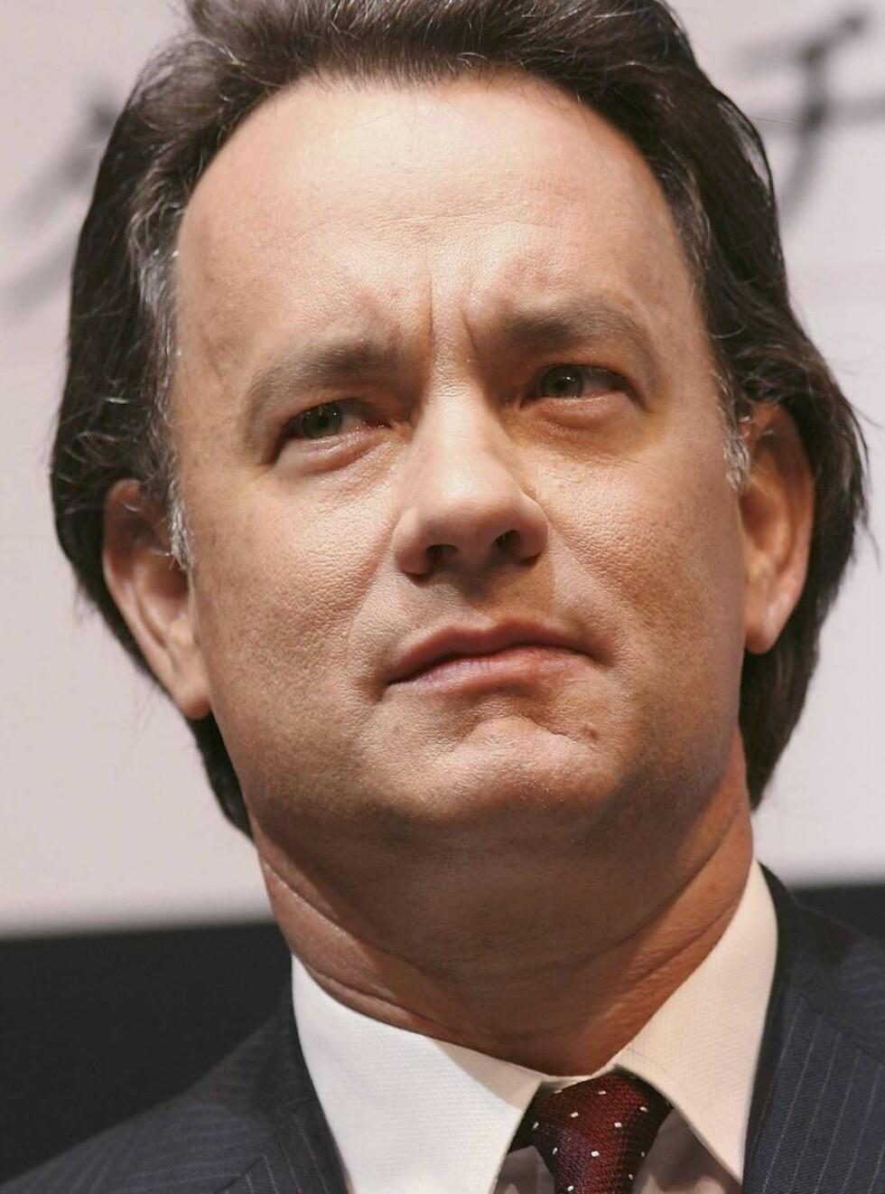 ENGASJERT: Tom Hanks mener Da Vinci-koden er en kjempesjanse for kirkens ledere. Foto: All Over Press