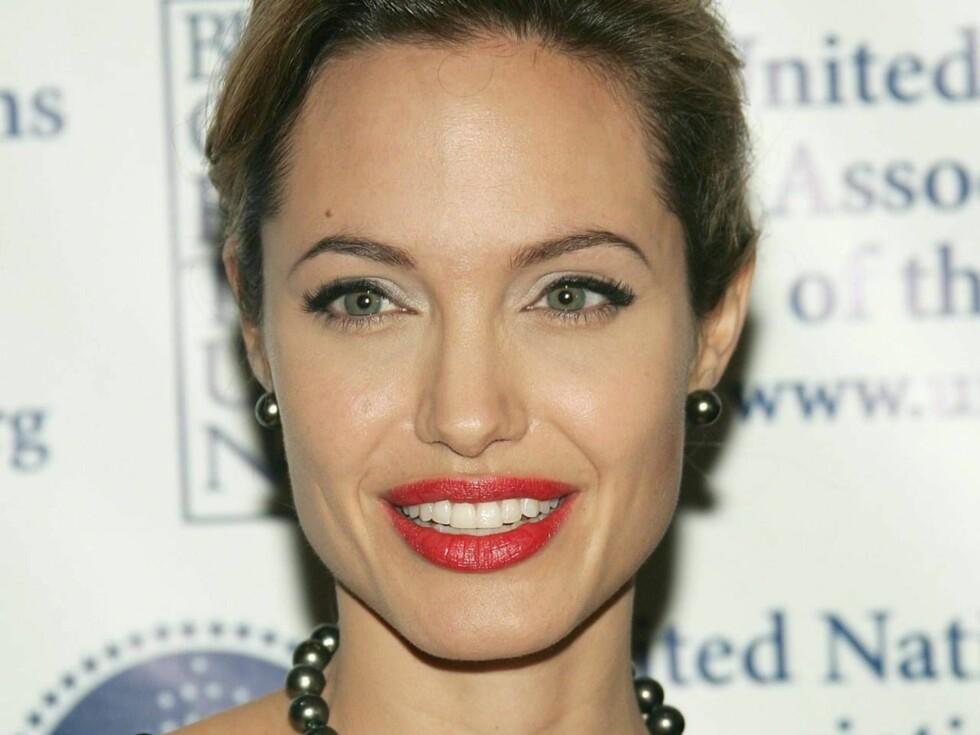 SNART MOR: Barnet Angelina venter blir utvilsomt et yndet fotoobjekt. Foto: All Over Press