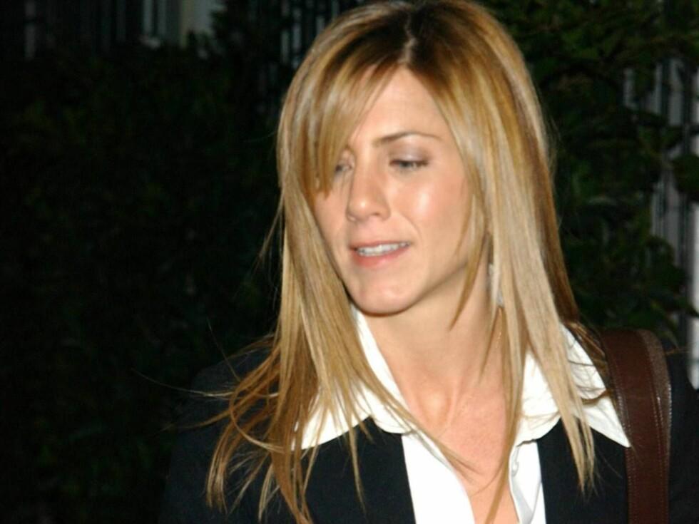 SØKER TURKAMERATER: Jennifer Aniston skulle nok ønske at hun hadde noen venner til passe på seg under de nattlige utfluktene... Foto: All Over Press