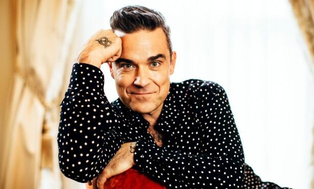 LEI: - Nå er det ikke morsomt lenger, sier Robbie Williams til magasinet Stella om kommentaren for 12 år siden, og som var ment som en spøk, fortsatt blir brukt mot ham. Foto: Jonathan Ng/Newspix/REX/Shutterstock
