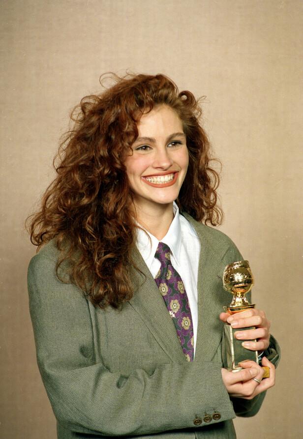 <strong>UNISEX-DRAKT:</strong> I 1990 dukket Julia Roberts opp i en unisex-drakt fra Giorgio Armani. - Jeg elsket formen på drakten, fortalte Roberts til InStyle. Foto: AP