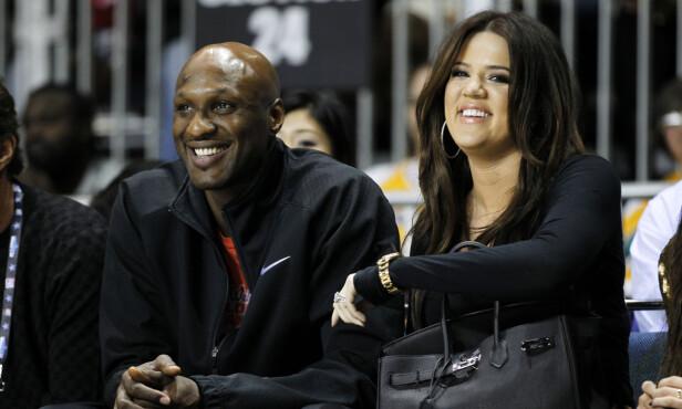 PENGEKRANGEL: Selv om Khloe var der for Lamar etter overdosen, har ikke Lamar noe til overs for Khloe lengre. Her på en basketballkamp i 2011. Foto: NTB scanpix