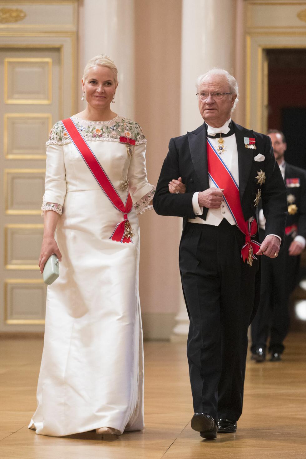 Kong Carl Gustaf av Sverige og kronprinsesse Mette-Marit.