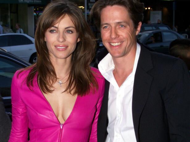 EKS-KJÆRESTER: Liz Hurley og Hugh Grant var et av Hollywoods heteste par. Her er de sammen på en filmpremiere i Los Angeles i 1999. Foto: NTB Scanpix