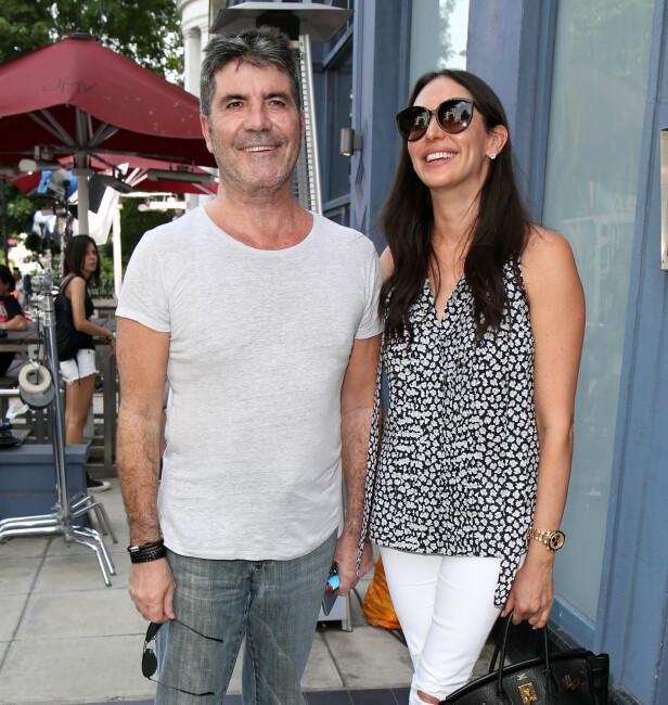 <strong>KJÆRESTER:</strong> Simon Cowell og Lauren Silverman ble foreldre til lille Eric i 2014. Foto: Shutterstock