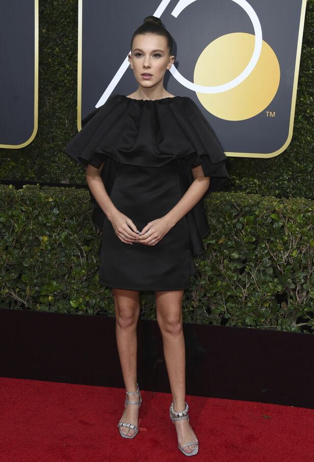 STJERNESKUDD: Millie Bobby Brown er bare 13, men har allerede rukket å bli en av verdens mest kjente skuespillere for sin rolle i «Stranger Things». Kjolen var signert Calvin Klein. Foto: NTB scanpix