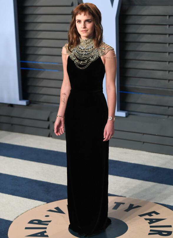 MED PANNELUGG: Skuespiller Emma Watson. Foto: NTB scanpix