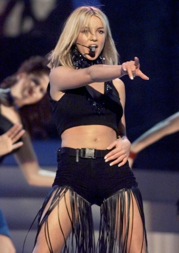 <strong>ELSKET SANG OG DANS:</strong> Britney Spears opptrer på Billboard Music Awards i 1999. Foto: Reuters/ NTB scanpix