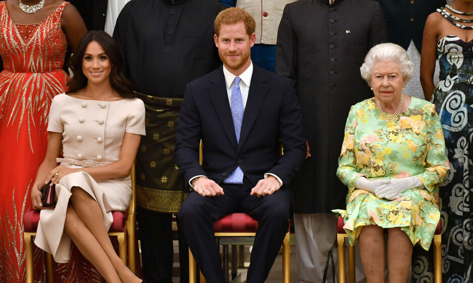 TRØTT?: Hertuginne Meghan avslørte at prins Harry kom hjem fra reise klokken seks om morgenen, samme dag som han og Meghan skulle delta på «The Queen's Young Leaders Awards»-utdelingen sammen med dronning Elizabeth. Foto: John Stillwell/ Reuters/ NTB scanpix