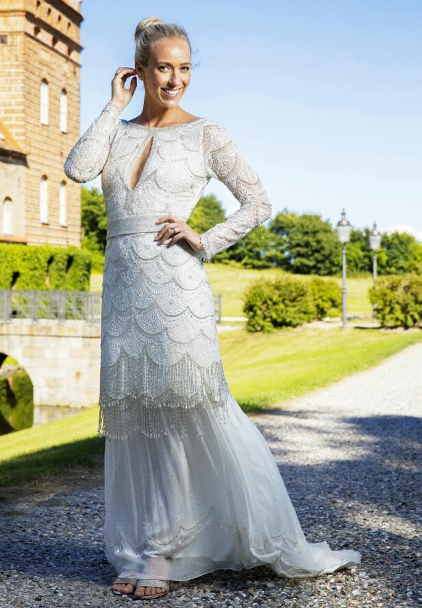 <strong>PRINSESSE:</strong> Ingen tvil om hvem som var vakrest i Danmark denne dagen. Den lekre brudekjolen er designet av Leila Hafzi. Foto: Espen Solli / Se og Hør