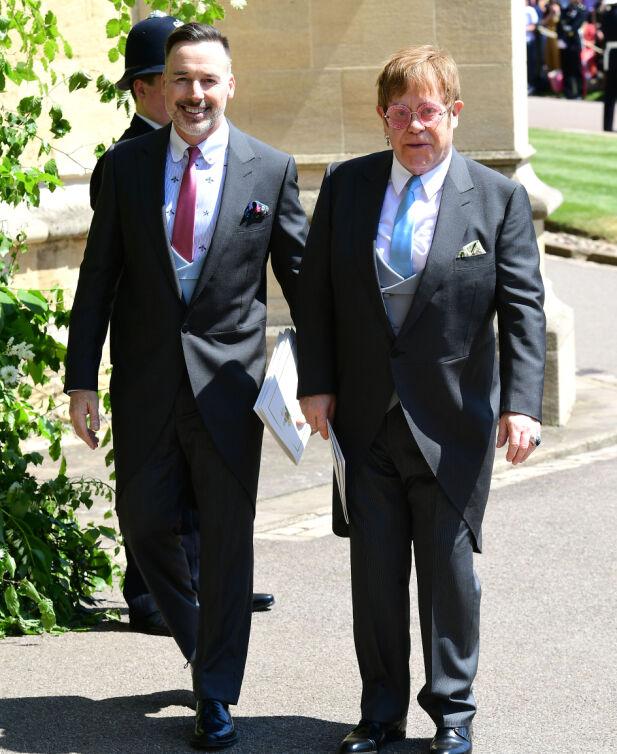 EKTEPAR: David og Elton forlater kirken etter vielsen til Meghan og Prins Harry i mai. Foto: NTB Scanpix