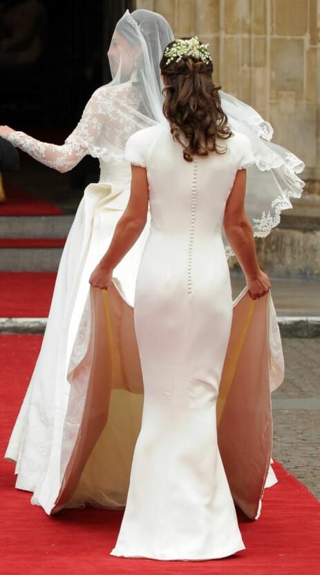 STJERNE OVER NATTEN: Pippa fikk mye oppmerksomhet under storesøsterens bryllup i 2011, grunnet denne tettsittende kjolen. Foto: NTB Scanpix
