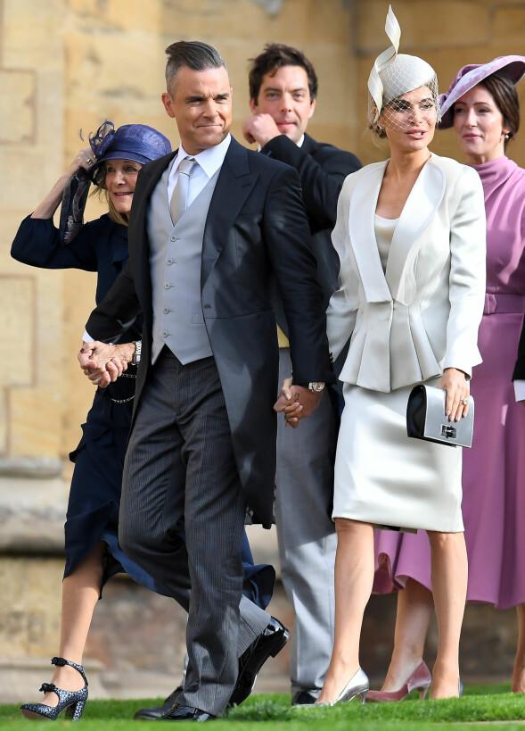 POPSTJERNE: Robbie Williams ankom hånd i hånd med kona Ayda Field. Foto: NTB scanpix