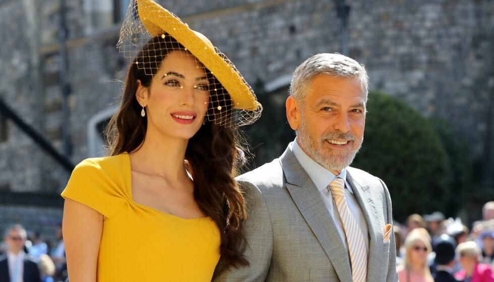 KONGELIG BRYLLUP: Amal og George var selvskrevne gjester i bryllupet til Harry og Meghan i mai. Foto: NTB Scanpix