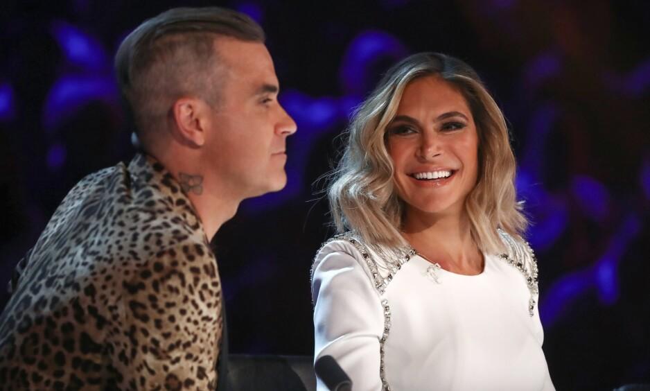 <strong>EKTEPAR OG KOLLEGER:</strong> Robbie Williams (44) og kona Ayda Field (39) er begge dommere i den britiske utgaven av sangkonkurransen «X Factor». Nå kommer Field med oppsiktsvekkende detaljer fra innspillingen. Foto: NTB Scanpix