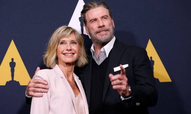 <strong>RADARPAR:</strong> Olivia Newton-John og John Travolta kommer nok alltid til å være forbundet med rollene som Sandy og Danny i den velkjente filmen «Grease». Her avbildet i fjor under 40-årsjubileet til suksessfilmen. Foto: NTB scanpix