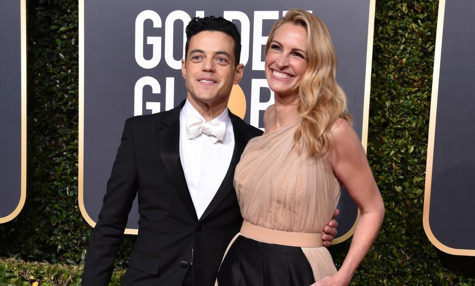 SKAPTE OPPSTYR: Rami Malek solte seg i glansen med Julia Roberts da han ankom årets Golden Globe-utdeling. På slutten av kvelden hevet mange øyenbrynene over at «Bohemian Rhapsody», der Malek spiller hovedrollen, stakk av gårde med kveldens kanskje gjeveste pris. Foto: NTB scanpix