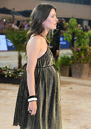 VISTE FREM MAGEN: Her struttet Charlotte stolt under et arrangement i Monaco i juni. Foto: NTB Scanpix