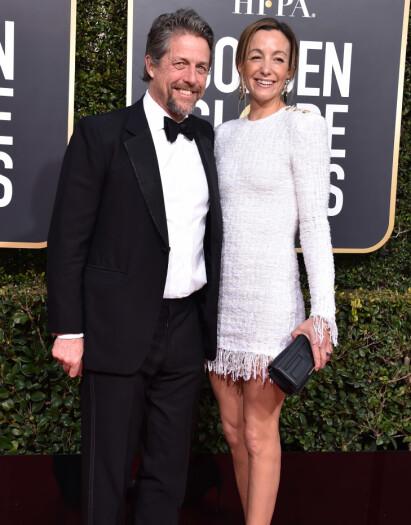 GIFT: Hugh Grant og svenske Anna Eberstein giftet seg i fjor. Her er de avbildet sammen under Golden Globe-utdelingen tidligere denne måneden. Foto: NTB Scanpix