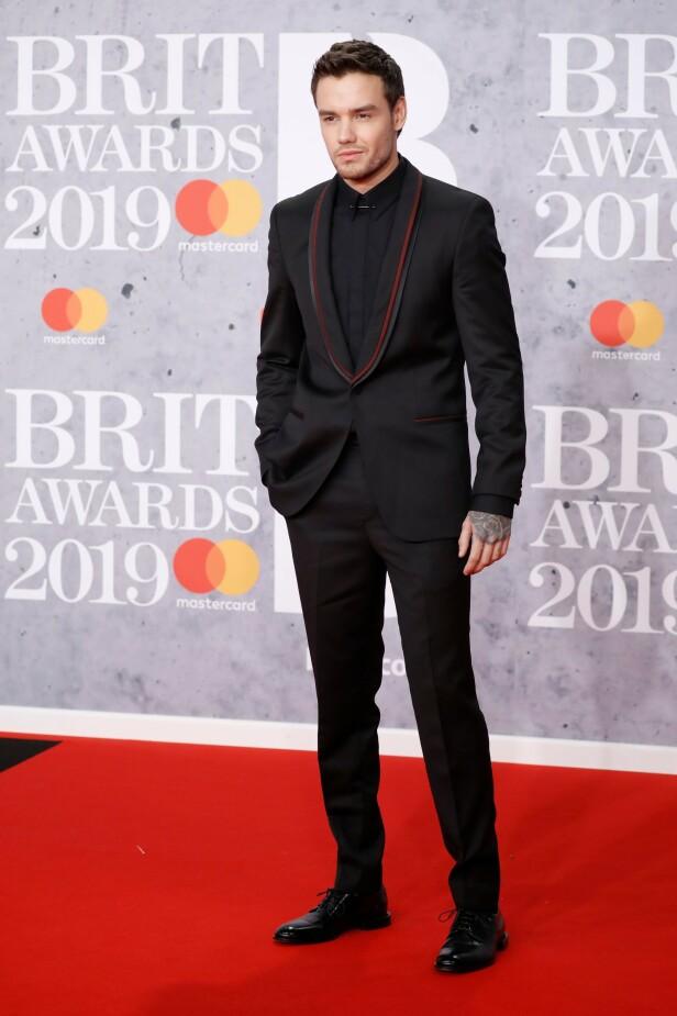 HELSVART: Liam Payne dukket opp alene på den røde løperen under kveldens Brit Awards. Dette fikk fansen til å undre på om det kan være over med Naomi Campbell. Foto: NTB scanpix