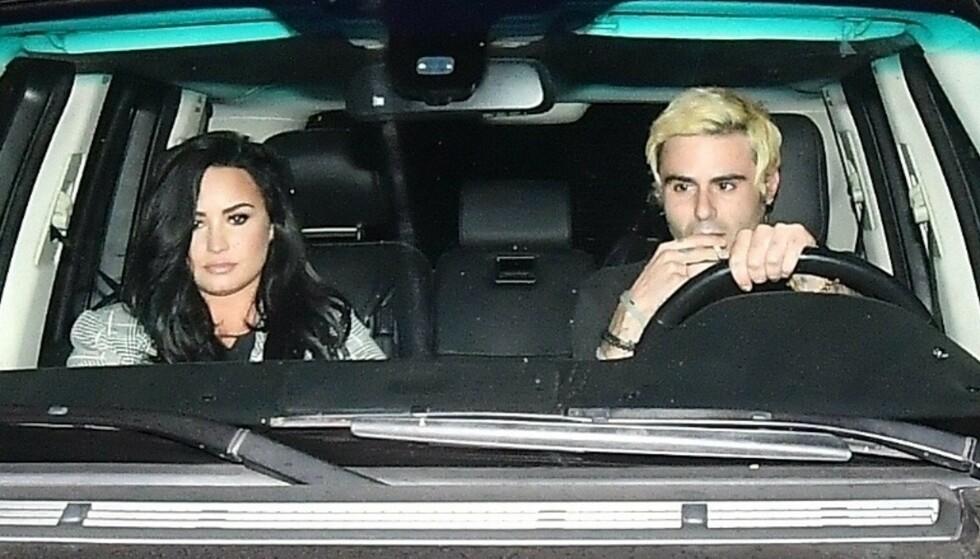 SINGEL: Sangfuglen Demi Lovato skal være ledig på markedet igjen, etter bruddet med Henry Levy (t.h.). Foto: NTB Scanpix