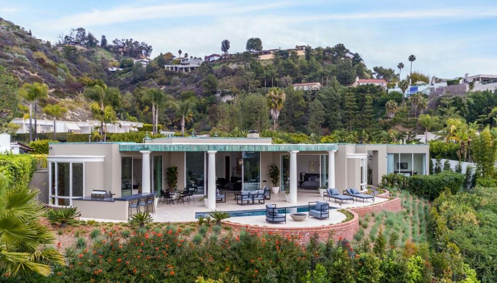 DRØMMEVILLA: Villaen til superparet har nok av plass - både innen- og utendørs. Foto: NTB Scanpix