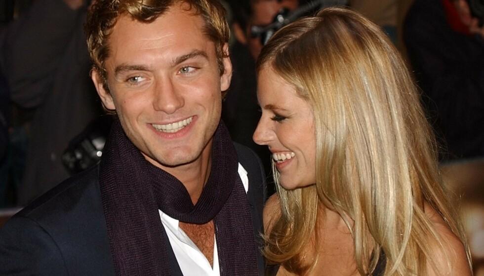 STJERNEPAR: Jude Law og Sienna Miller hadde et svært profilert og stormfullt kjærlighetsforhold. Her på «Alfie»-premieren i London i oktober 2004. Foto: AP/ NTB scanpix