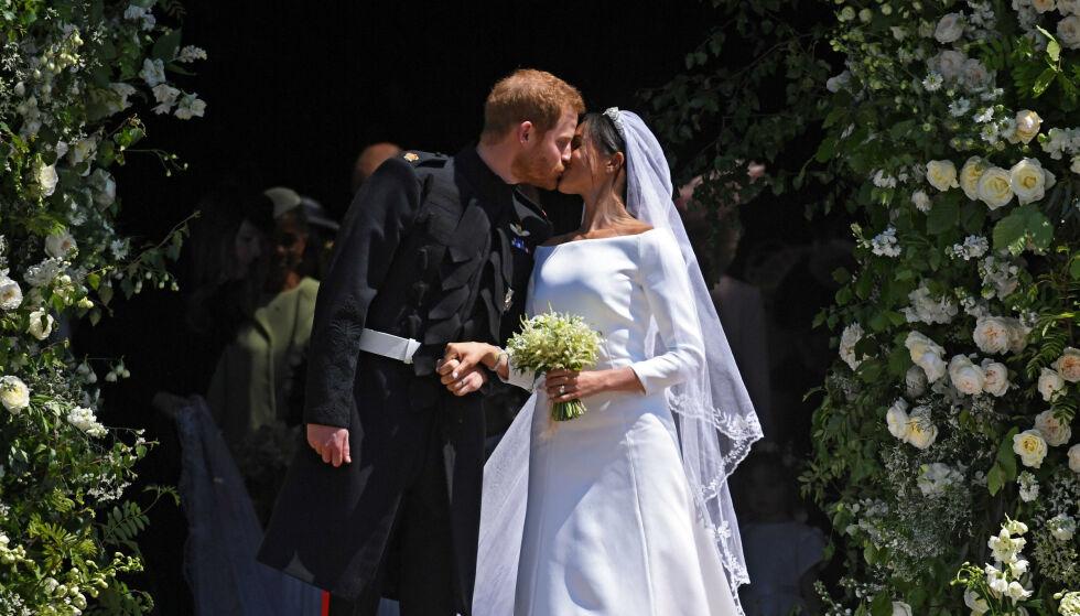MIDTPUNKTET: Bryllupet og dette kysset ble sett av millioner verden over. Foto: NTB Scanpix