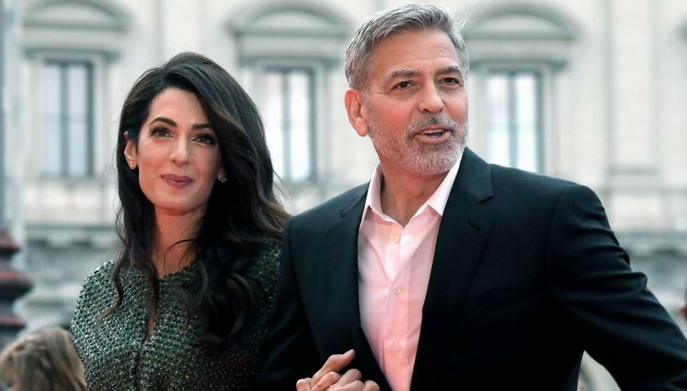 BRUKER SEG SELV: Er man heldig kan man nå dra på date med George og Amal Clooney. Foto: NTB Scanpix