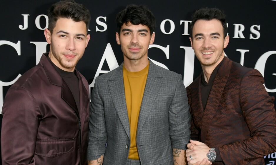 <strong>POPULÆR TRIO:</strong> F.v: Nick, Joe og Kevin Jonas har både gjort karriere sammen i bandet The Jonas Brothers og med egne prosjekter. Her er de avbildet sammen under Los Angeles-premieren av dokumentaren Chasing Happiness mandag. Foto: NTB Scanpix