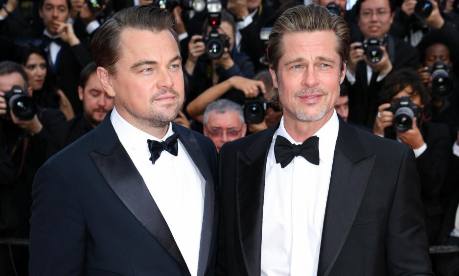 MISBRUKT: Skuspiller Brad Pitt fikk navn og bilde misbrukt i en anti-homofili-kampanje. Det fikk ham til å reagere. Her med «Once Upon a Time in Hollywood»-kollega Leonardo DiCaprio (t.v.) i Cannes i mai. Foto: NTB Scanpix