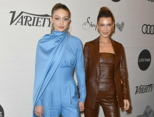 MODELLSØSTRE: Både Gigi og Bella Hadid er noen av verdens mest ettertraktede modeller. Her hånd i hånd på et event i New York i april. Foto: NTB Scanpix