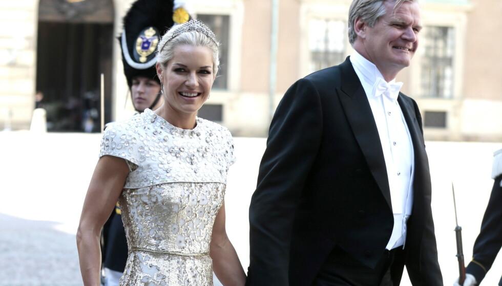 UTLYSER STILLING: Celina Midelfart (46) og Tor Olav Trøim (56) har utlyst en stilling som barnevakt og rengjører til deres felles hjem på Frogner i Oslo. Her er paret avbildet i 2013 i bryllupet til prinsesse Madeleine og Chris O'Neill i Sverige. Foto: NTB scanpix