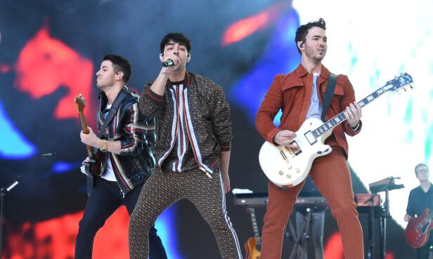 COMEBACK: Jonas-brødrene er sammen på scenen igjen etter en pause på seks år. Her på Wembley Stadium. Foto: NTB Scanpix