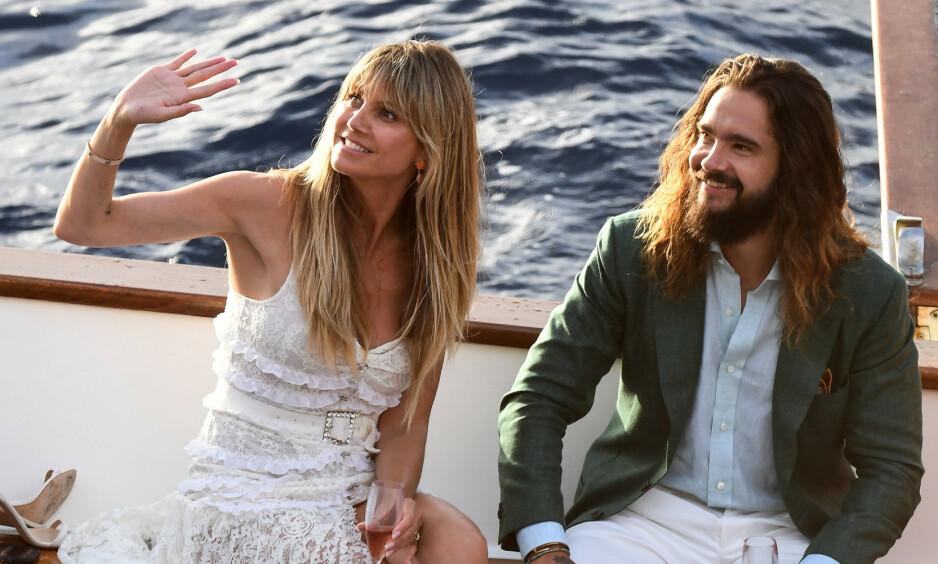 <strong>NYGIFT:</strong> I starten av august giftet Heidi Klum og Tom Kaulitz seg for andre gang. Nå viser det seg at de har brutt italiensk lov under oppholdet, og kan dermed vente seg en saftig bot. Foto: NTB Scanpix