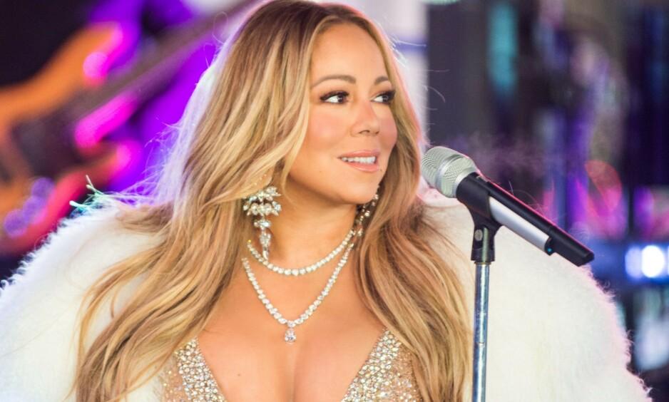 TØFF OPPVEKST: Sangstjernen Mariah Carey åpner opp om sin tøffe oppvekst, og forteller at det er vanskelig å oppdra de to barna sine til å sette pris på det de har. Foto: NTB Scanpix