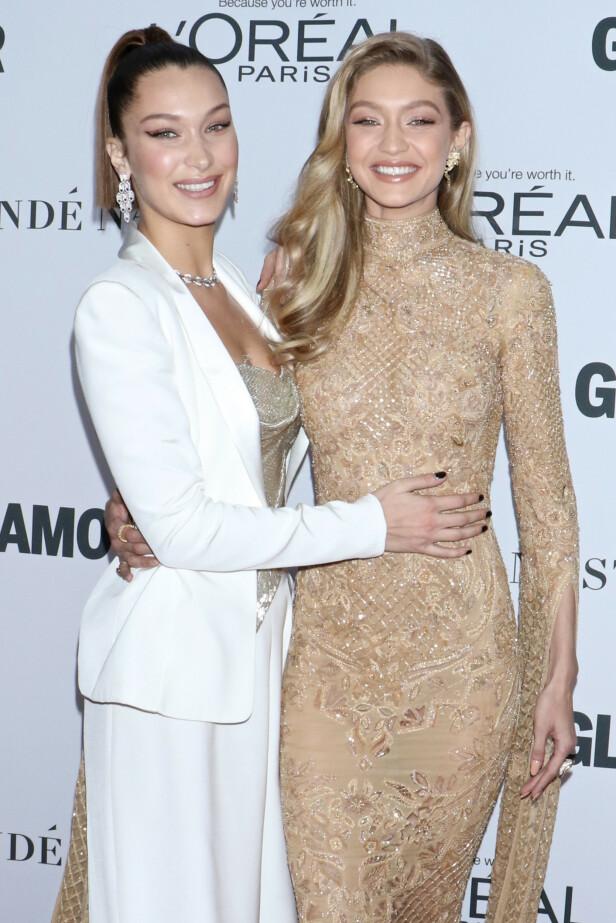 BRUNETTE OG BLONDINE: Bella og Gigi Hadid slik man er vant til å se dem. Nå har begge lyse lokker. Foto: NTB Scanpix