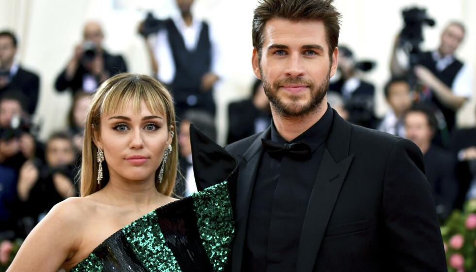 <strong>OVER OG UT:</strong> Kjærligheten mellom stjerneparet Miley Cyrus og Liam Hemsworth skulle ikke holde. Foto: NTB Scanpix