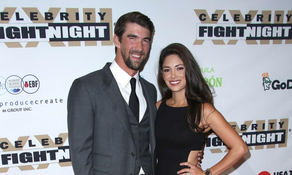 TRAVEL HVERDAG: I 2016 la Michael Phelps svømmekarrieren på hylla, men han ligger ikke på latsiden av den grunn. I løpet av disse årene har han nemlig rukket å bli trebarnsfar. Her med kona Nicole på et event i 2017. Foto: NTB Scanpix