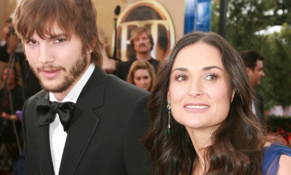 EKSPAR: I sin nye selvbiografi avslører Demi Moore at hun og eksmannen Ashton Kutcher ventet barn før de giftet seg. Den lille jenta hadde allerede fått navn. Her er de to på SAG Awards i 2007. Foto: NTB Scanpix