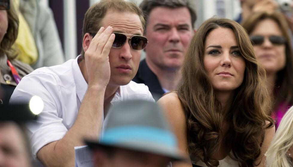TOPPLØS: I 2012 ble hertuginne Kate avbildet toppløs på ferie med prins William. Her er ekteparet avbildet under OL i London samme år. Foto: NTB Scanpix