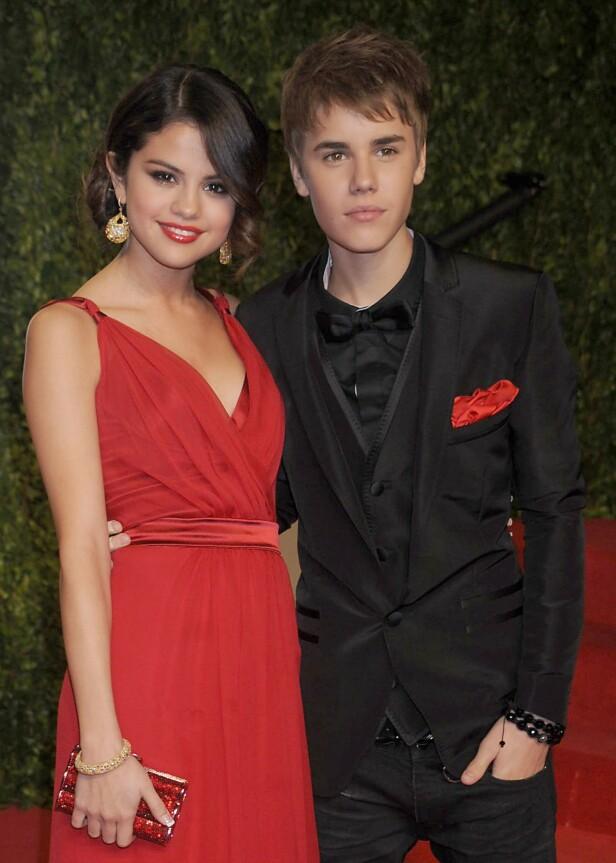 TURBULENT FORHOLD: Ungpikeidolet Justin Bieber og Disney-stjernen Selena Gomez var et av verdens hotteste par da de var kjærester fra 2011 til 2013. Her er de avbildet i 2011. Foto: NTB Scanpix