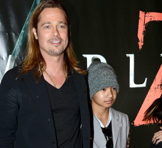 FRA LYKKELIGE TIDER: Her er Brad og Maddox sammen på en filmpremiere i 2013 mens familiebåndene fremdeles var i god behold. Foto: NTB Scanpix