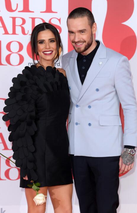 GIKK HVER TIL SITT: I juli i fjor kom nyheten om at Liam Payne og Cheryl Cole hadde besluttet å ende forholdet. Den triste nyheten delte stjerneparet i et innlegg på Twitter. Foto: NTB Scanpix