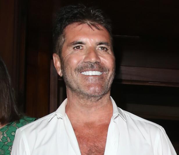 <strong>FORANDRET:</strong> Flere bet seg merke i at Cowell hadde forandret seg da han dukket opp på sommerfest. Foto: NTB Scanpix